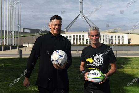 Former Australian soccer player Craig Foster (R) and National Rugby League (NRL) star Sonny Bill Williams (L) pose for photos during a media event, to deliver a petition, outside Parliament House in Canberra, Australia, 28 October 2020. Craig Foster Sonny Bill Williams have jointly called on the Australian Government to accept New Zealand's offer to resettle refugees. The offer was made in 2013.