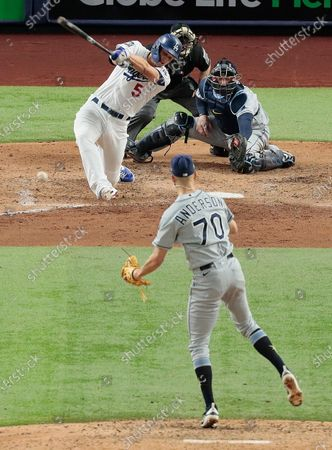 Stock Image of Arlington, Texas, Tuesday, October 27, 2020 Los Angeles Dodgers shortstop Corey Seager (5) hits a fielders choice grounder to score Mookie Betts in the sixth inning in game six of the World Series at Globe Life Field. (Robert Gauthier/ Los Angeles Times)