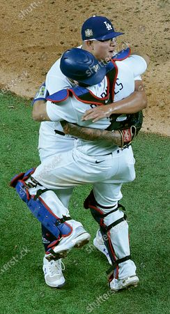 Stock Photo of Arlington, Texas, Tuesday, October 27, 2020 Austin Barnes and Julio Urias embrace after the final out in game six of the World Series at Globe Life Field. (Robert Gauthier/ Los Angeles Times)