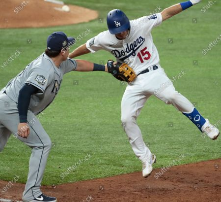 Stock Image of Arlington, Texas, Tuesday, October 27, 2020 Los Angeles Dodgers catcher Austin Barnes (15)/ jumps as he is tagged out by Tampa Bay Rays first baseman Ji-Man Choi (26) in the third inning game six of the World Series at Globe Life Field. (Robert Gauthier/ Los Angeles Times)