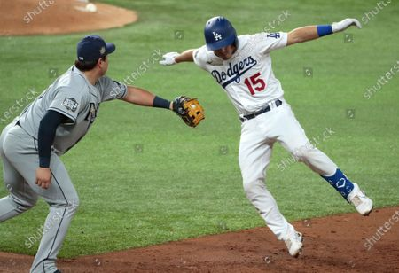 Arlington, Texas, Tuesday, October 27, 2020 Los Angeles Dodgers catcher Austin Barnes (15)/ jumps as he is tagged out by Tampa Bay Rays first baseman Ji-Man Choi (26) in the third inning game six of the World Series at Globe Life Field. (Robert Gauthier/ Los Angeles Times)