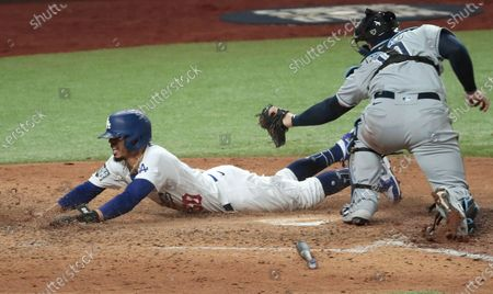 Arlington, Texas, Tuesday, October 27, 2020 Los Angeles Dodgers right fielder Mookie Betts (50) scores ahead of the tag of Tampa Bay Rays catcher Mike Zunino (10) on a Corey Seager grounder in game six of the World Series at Globe Life Field. (Robert Gauthier/ Los Angeles Times)