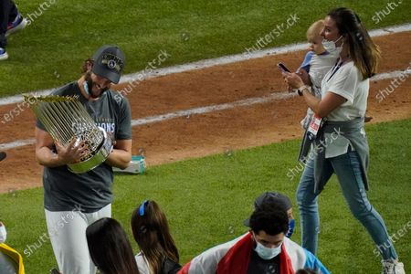 Los Angeles Dodgers starting pitcher Clayton Kershaw celebrates with the trophy after defeating the Tampa Bay Rays 3-1 to win the baseball World Series in Game 6, in Arlington, Texas