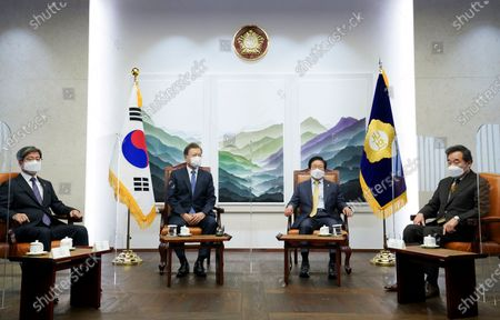 South Korea President Moon Jae-in (2-L) talks with Speaker of the National Assembly Park Byeong-seug (2-R), Supreme Court Chief Justice Kim Myeong-su (L) and Lee Nak-yon (R), head of the ruling Democratic Party, prior to delivering a speech on his administration's budget plan for the coming year, at the National Assembly in Seoul, South Korea, 28 October 2020.
