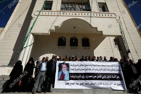 Yemenis hold a banner depicting senior Houthi official Hassan Zaid a day after he was killed by gunmen in Sanaa, Yemen, 28 October 2020. According to reports, the youth and sports minister of the Houthi administration Hassan Zaid was killed in an attack by gunmen as he was heading to his office in the capital Sanaa.