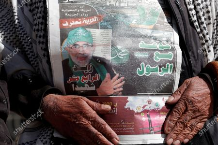 A Yemeni holds a local daily newspaper with a picture of senior Houthi official Hassan Zaid a day after he was killed by gunmen in Sanaa, Yemen, 28 October 2020. According to reports, the youth and sports minister of the Houthi administration Hassan Zaid was killed in an attack by gunmen as he was heading to his office in the capital Sanaa.