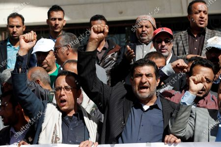 Yemenis shout slogans during a rally a day after a senior Houthi official was killed by gunmen in Sanaa, Yemen, 28 October 2020. According to reports, the youth and sports minister of the Houthi administration Hassan Zaid was killed in an attack by gunmen as he was heading to his office in the capital Sanaa.