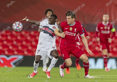 """Liverpool's James Milner (R, front) grapples with FC Midtjylland's Pione Sisto (L, front) during the UEFA Champions League match between Liverpool FC and FC Midtjylland at Anfield in Liverpool, Britain, on Oct. 27, 2020. (Xinhua) FOR EDITORIAL USE ONLY. NOT FOR SALE FOR MARKETING OR ADVERTISING CAMPAIGNS. NO USE WITH UNAUTHORIZED AUDIO, VIDEO, DATA, FIXTURE LISTS, CLUB/LEAGUE LOGOS OR """"LIVE"""" SERVICES. SUN OUT. ONLINE IN-MATCH USE LIMITED TO 45 IMAGES, NO VIDEO EMULATION. NO USE IN BETTING, GAMES OR SINGLE CLUB/LEAGUE/PLAYER PUBLICATIONS. - Han Yan -"""