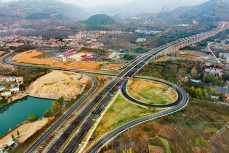 Aerial photo shows the Jinan-Tai'an expressway in east China's Shandong Province, Oct. 27, 2020. The expressway linking Jinan and Tai'an in east China's Shandong Province was put into operation on Tuesday. The expressway will shorten the travel time between the two places to half an hour after its operation.