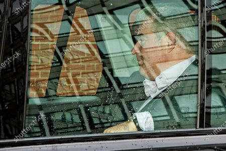 Secretary of State for Northern Ireland Brandon Lewis is seen without a face mask as he is driven through Westminster in his ministerial car .
