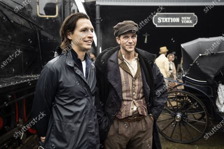 Stock Image of Film producer Fredrik Wikstrom Nicastro and Gustaf Skarsgard as Karl-Oskar during the filming of the movie, based on Swedish author Vilhelm Moberg's book