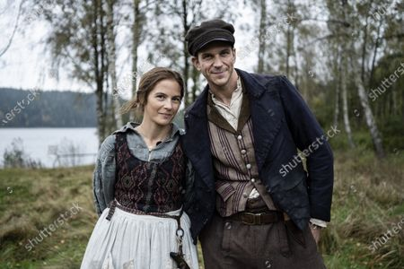 Lisa Carlehed as Kristina and Gustaf Skarsgard as Karl-Oskar during the filming of the movie, based on Swedish author Vilhelm Moberg's book