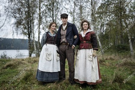 Stock Photo of Lisa Carlehed as Kristina, Gustaf Skarsgard as Karl-Oskar and Tove Lo as Ulrika during the filming of the movie, based on Swedish author Vilhelm Moberg's book