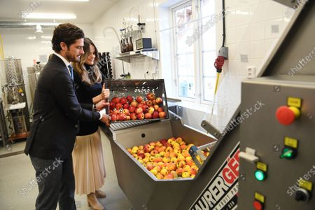 Prince Carl Philip and Princess Sofia make apple juice during the visit to Kulinarika at Aplungen, a restaurant and vineyard south of Sunne, Sweden. The Prince Couple are spending the day in Varmland County to see how it has been affected by Covid-19.