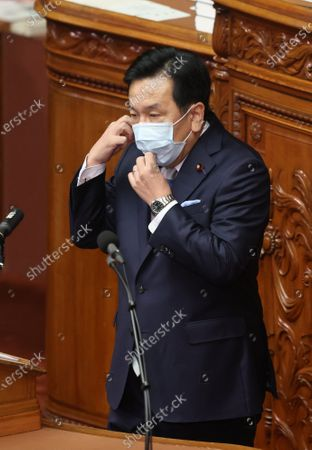 Japan's main opposition Constitutional Democratic Party of Japan leader Yukio Edano removes his face mask as he questions to Prime Minister Yoshihide Suga at Lower House's plenary session at the National Diet in Tokyo on Wednesday, October 28, 2020. Suga delivered his first policy speech at the Diet on October 26.