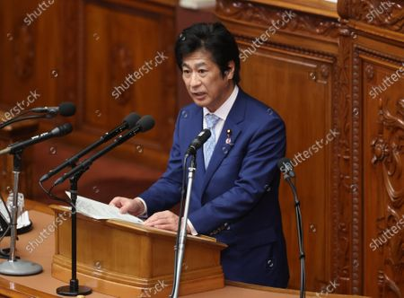 Japanese Health Minister Norihisa Tamura answers questions to an opposition leader Yukio Edano of the Constitutional Democratic Party of Japan at Lower House's plenary session at the National Diet in Tokyo on Wednesday, October 28, 2020. Prime Minister Yoshihide Suga delivered his first policy speech at the Diet on October 26.