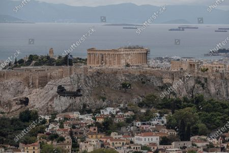 Military helicopter flies in front of the Parthenon temple on the ancient Acropolis hill in Athens, during a national holiday . Helicopters fly next to Acropolis hill to celebrate Greece's refusal to align itself with a belligerent fascist Italy in 1940 and instead fight a much stronger opponent, a decision which dragged it into World War II and eventually led to a brutal occupation by Nazi Germany