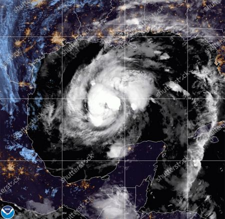 This satellite image provided by the National Oceanic and Atmospheric Administration shows Tropical Storm Zeta, at 10:52 GMT (06:52 EDT