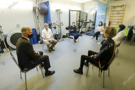 King Philippe of Belgium and Molenbeek mayor Catherine Moureaux pictured during a royal visit to the local health center WGC De Brug