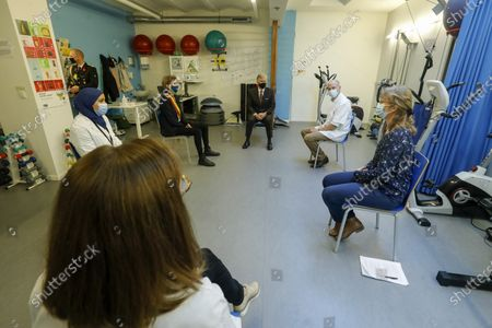 Stock Picture of King Philippe of Belgium and Molenbeek mayor Catherine Moureaux pictured during a royal visit to the local health center WGC De Brug