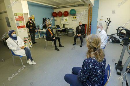 Stock Image of King Philippe of Belgium and Molenbeek mayor Catherine Moureaux pictured during a royal visit to the local health center WGC De Brug