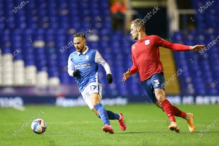 Ivan Sanchez (17) of Birmingham City protects the ball from Harry Toffolo (3) of Huddersfield Town