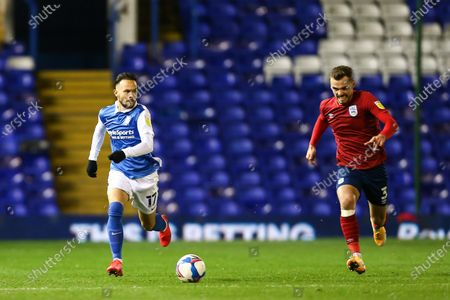 Ivan Sanchez (17) of Birmingham City and Harry Toffolo (3) of Huddersfield Town chase the ball