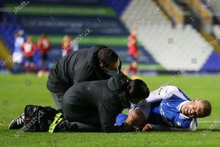 Stock Picture of Adam Clayton (8) of Birmingham City in pain after a bad foul