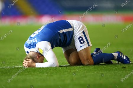 Adam Clayton (8) of Birmingham City is down injured