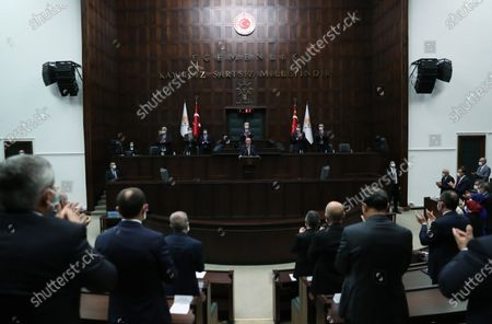 A handout photo made available by Turkish President Press Office shows Turkish President and leader of the Justice and Development Party (AK Party) Recep Tayyip Erdogan (C) addressing his party's group meeting at the Turkish Grand National Assembly in Ankara, Turkey, 28 October 2020.