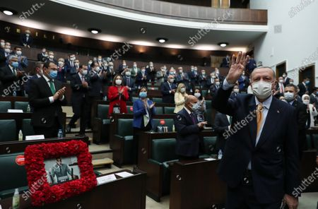 A handout photo made available by Turkish President Press Office shows Turkish President and leader of the Justice and Development Party (AK Party) Recep Tayyip Erdogan (R) addressing his party's group meeting at the Turkish Grand National Assembly in Ankara, Turkey, 28 October 2020.