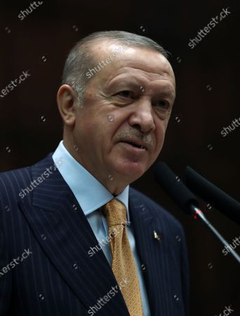 A handout photo made available by Turkish President Press Office shows Turkish President and leader of the Justice and Development Party (AK Party) Recep Tayyip Erdogan addressing his party's group meeting at the Turkish Grand National Assembly in Ankara, Turkey, 28 October 2020.