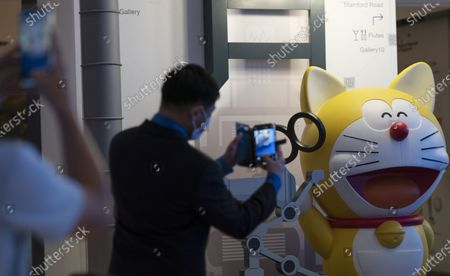 People take photos of exhibits from Doraemon's Time-Travelling Adventures exhibition at the National Museum of Singapore in Singapore, 28 October 2020. The year 2020 marks the 50th anniversary of the birth of the beloved Japanese manga character Doraemon from the popular animated series and comics of the same name. The exhibition featuring the robot cat cultural icon at the National Museum of Singapore will run until 27 December 2020.