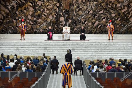A handout picture provided by the Vatican Media shows Pope Francis attending the general audience in the Paul VI hall, Vatican City, 28 October 2020.