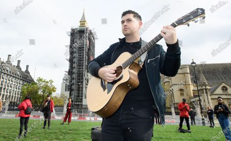 Singers perform in parliament Square as part of #wemakeevents 'Survival in the Square' initiative.Taking place across 6 days 'Survival in the Square' is a series of individual performances being held to raise awareness of the current plight facing the entertainment industry as a result of the Covid 19 crisis. Tom Rosenthal