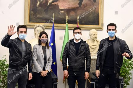 Stock Image of The Mayor of Rome Virginia Raggi (2-L) with Gianluca Ginoble (L), Piero Barone (2-R) and Ignazio Boschetto (R) of the Italian operatic pop tenors Il Volo attend a press presentation of the tribute event 'Il Volo Tribute to Ennio Morricone' in Rome, Italy, 28 October 2020. The tribute concert dedicated to the late Italian composer Ennio Morricone is to be held in Rome on 05 June 2021.