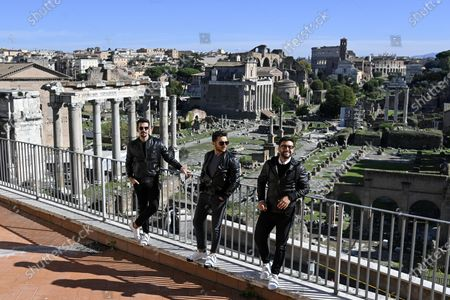 Ignazio Boschetto, Gianluca Ginoble and Piero Barone of the Italian operatic pop tenors trio Il Volo pose in front of the Roman Forum during a press presentation of the tribute event 'Il Volo Tribute to Ennio Morricone' in Rome, Italy, 28 October 2020. The tribute concert dedicated to the late Italian composer Ennio Morricone is to be held in Rome on 05 June 2021.