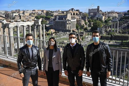 The Mayor of Rome Virginia Raggi (2-L) poses with Gianluca Ginoble (L), Piero Barone (2-R) and Ignazio Boschetto (R) of the Italian operatic pop tenors Il Volo  in front of the Roman Forum during a press presentation of the tribute event 'Il Volo Tribute to Ennio Morricone' in Rome, Italy, 28 October 2020. The tribute concert dedicated to the late Italian composer Ennio Morricone is to be held in Rome on 05 June 2021.