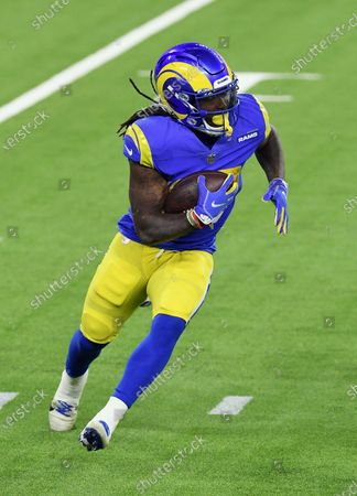 Los Angels Rams running back Darrell Henderson (27) gains yards on a run during an NFL football game against the Chicago Bears, in Inglewood, Calif. The Rams defeated the Bears 24-10