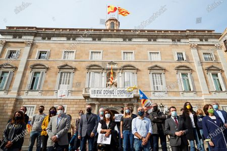 Stock Photo of Former Catalan regional President Quim Torra (2-L, front), acting Catalan regional President, Pere Aragones (2-R, front) attend a rally against the judicial inquiry of the alleged leakage of funds for financing former Catalan regional President Carles Puigdemont's expenses in Waterloo, Belgium, at Sant Jaume Square, in Barcelona, Catalonia, Spain, 28 October 2020. Several pro-independent groups organized the protest amid the Civil Guard operation in which some people from Puigdemont's inner circle, including former regional minister Xavier Vendrell, publisher Josep Lluis Alay, were arrested.