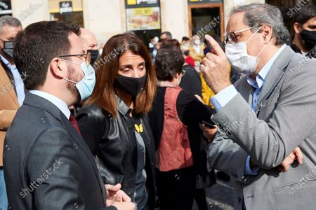 Former Catalan regional President Quim Torra (R) chats with his substitute, acting Catalan regional President, Pere Aragones (L), during a rally against the judicial inquiry of the alleged leakage of funds for financing former Catalan regional President Carles Puigdemont's expenses in Waterloo, Belgium, at Sant Jaume Square, in Barcelona, Catalonia, Spain, 28 October 2020. Several pro-independent groups organized the protest amid the Civil Guard operation in which some people from Puigdemont's inner circle, including former regional minister Xavier Vendrell, publisher Josep Lluis Alay, were arrested.