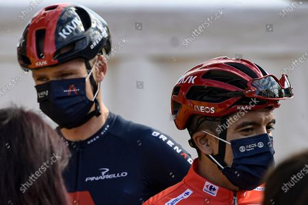 Ineos's Richard Carapaz, red shirt leader of La Vuelta, right, talks to the media close to Chris Froome during checkpoint control before starting the eighth stage of La Vuelta between Logrono and Alto de Moncalvillo, in Logrono, northern Spain