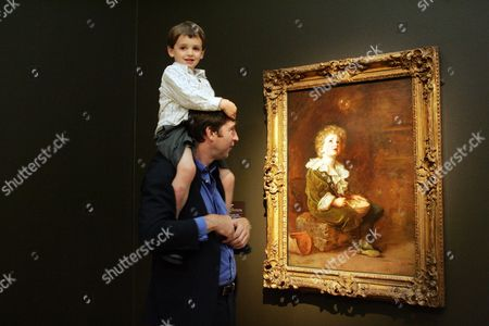 Exhibition Of Paintings By Sir John Everett Millais Opens At Tate Britain. Pihotographed Are Joshua Millais Gt Gt Grandson And Jude Millais ( 4 1/2yrs) Gt Gt Gt Grandson With 'bubbles' The Great Great Grandson Of Artist Sir John Everett Millais Took His Own Four-year-old Son To See The Biggest Exhibition Of His Work For 40 Years. As Joshua Millais Stood In Front Of One Of His Ancestor's Greatest Known Works Bubbles Used For Pears Soap Advertisements With His Son Jude He Said He Thought The Tate Britain Show Was 'quite Beautiful And Wonderful'. Mr Millais 46 A Photographer From Notting Hill Said: 'it's So Lovely To See So Much Work I've Never Seen Before Like The Landscapes Which Are Just Beautiful To See. It's Quite A Hard Thing To Live Up To It's Probably Why I Didn't Become A Painter. I'm So Proud Of Him.' Mr Millais Was Taken To See The Last Big Show At The Royal Academy In 1967. The New Show Consists Of About 140 Paintings From The Famous Depiction Of Shakespeare's Ophelia To Works Not Shown Since The 19th Century. Curator Alison Smith Said She Believed The Exhibition Would Transform Understanding Of Millais And Convince Even The Most Sniffy Critics. Although He Was The Best-known And Most Successful Painter In Britain In The Second Half Of The 19th Century Millais Was Treated With More Theatre's Homage Suspicion In The 20th Century When Many Thought His Work Overemotional. Dr Smith Said: 'most People Know A Couple Of Images Such As Ophelia And Some Of The Later Paintings Such As Bubbles. But Looking At Millais In His Entirety He Comes Out As A Fantastic Painter And Figure In British Art. 'people Will Be Astonished. He Was An Innovator And A Pioneer Of Human Psychology Pre- Freud.' Millais Was Born In Southampton In 1829 And At The Age Of 11 Became The Youngest Person To Win A Place At The Royal Academy Schools. He Founded The Pre-raphaelite Homage Brotherhood With William Holman Hunt And Dante Gabriel Rossetti And Became The First Artist To