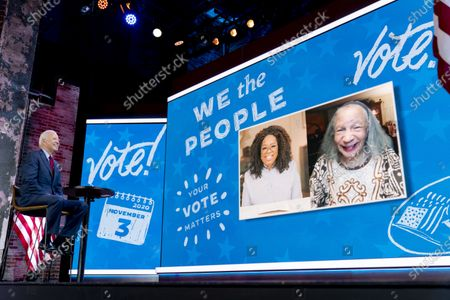 """Democratic presidential candidate former Vice President Joe Biden surprises Mildred Madison, 94, right, on a """"Zoom with Oprah Winfrey"""" virtual show at The Queen theater in Wilmington, Del., . Madison traveled 300 Miles from the Chicago area to Detroit to make sure her vote counted for Joe Biden"""