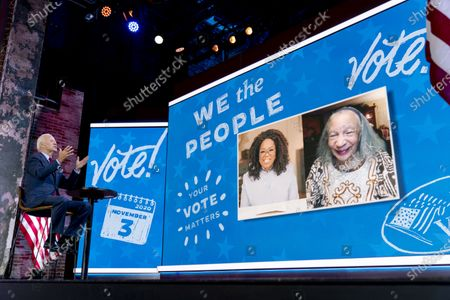 """Democratic presidential candidate former Vice President Joe Biden speaks with Mildred Madison, 94, right, on a """"Zoom with Oprah Winfrey"""" virtual show at The Queen theater in Wilmington, Del., . Madison traveled 300 Miles from the Chicago area to Detroit to make sure her vote counted for Joe Biden"""