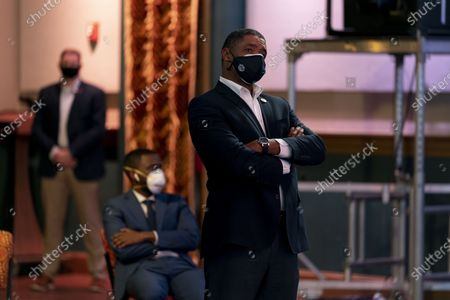 """Rep. Cedric Richmond, D-La., right, watches as Democratic presidential candidate former Vice President Joe Biden appears on a """"Zoom with Oprah Winfrey"""" virtual show at The Queen theater in Wilmington, Del"""