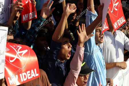 Pakistani people shout slogans during a demonstration against French President Macron's comments over Prophet Muhammad caricatures, outside the France consult in Karachi, Pakistan, 28 October 2020. A group of protesters gathered to protest against Macron's comments following the recent beheading of a teacher in France, after he had shown caricatures of the Prophet Muhammad in class. Pakistani Prime Minister Imran Khan, had also accused Macron of attacking and hurting the sentiments of millions of Muslims in Europe and across the world.