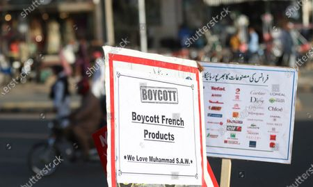 Pakistani carry placards during a demonstration against French President Macron's comments over Prophet Muhammad caricatures, outside the France consulate in Karachi, Pakistan, 28 October 2020. A group of protesters gathered to protest against Macron's comments following the recent beheading of a teacher in France, after he had shown caricatures of the Prophet Muhammad in class. Pakistani Prime Minister Imran Khan, had also accused Macron of attacking and hurting the sentiments of millions of Muslims in Europe and across the world.