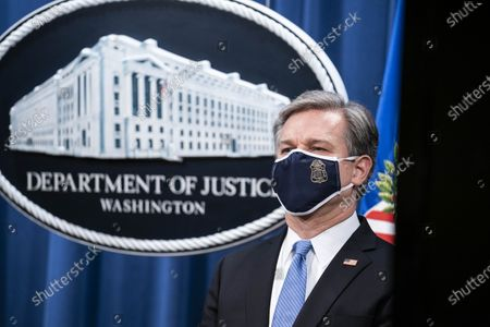 FBI Director Christopher Wray participates in a virtual news conference at the Department of Justice in Washington, DC, USA, 28 October 2020. Eight people have been arrested in connection to 'Operation Fox Hunt' an effort by China to threaten and coerce Chinese nationals viewed as threats to the regime to return to the country.