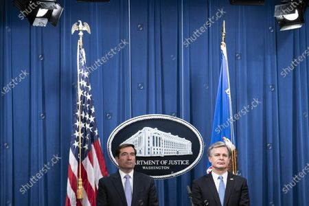 Stock Picture of Assistant Attorney General for National Security John C. Demers, left, and FBI Director Christopher Wray participate in a virtual news conference at the Department of Justice in Washington, DC, USA, 28 October 2020. Eight people have been arrested in connection to 'Operation Fox Hunt' an effort by China to threaten and coerce Chinese nationals viewed as threats to the regime to return to the country.